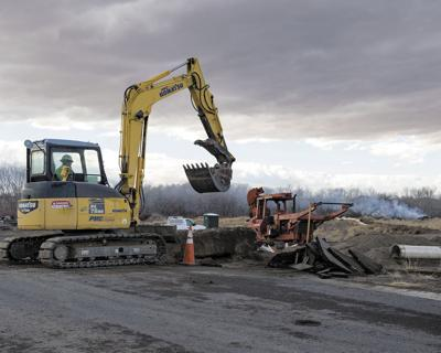 A construction worker uses heavy equipment