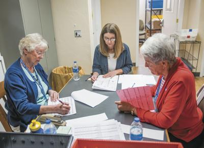 Mary Ross, left, Ronda Motsko and Nancy Ball are shown at work on tallies