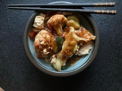 FOOD: Dumplings with tofu tomato sauce and stir-fried vegetables