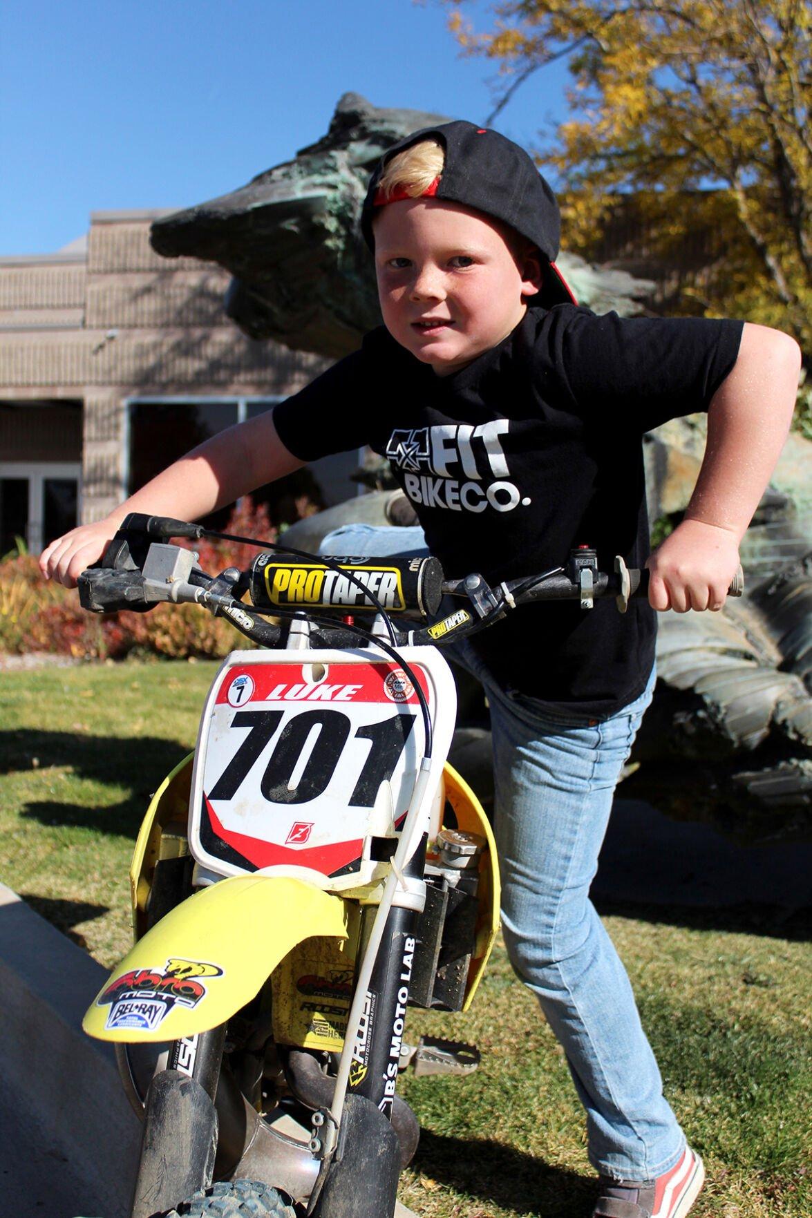 Noah getting on his bike