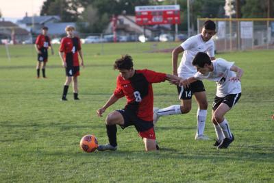 MHS boys soccer Aiden Harrell fighting for ball v Grand Junction