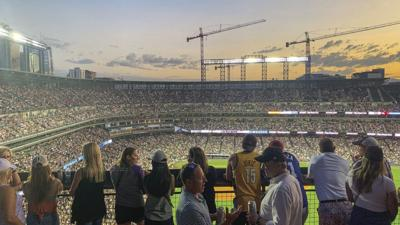 Fans watch the Colorado Rockies take on the Los Angeles Dodgers