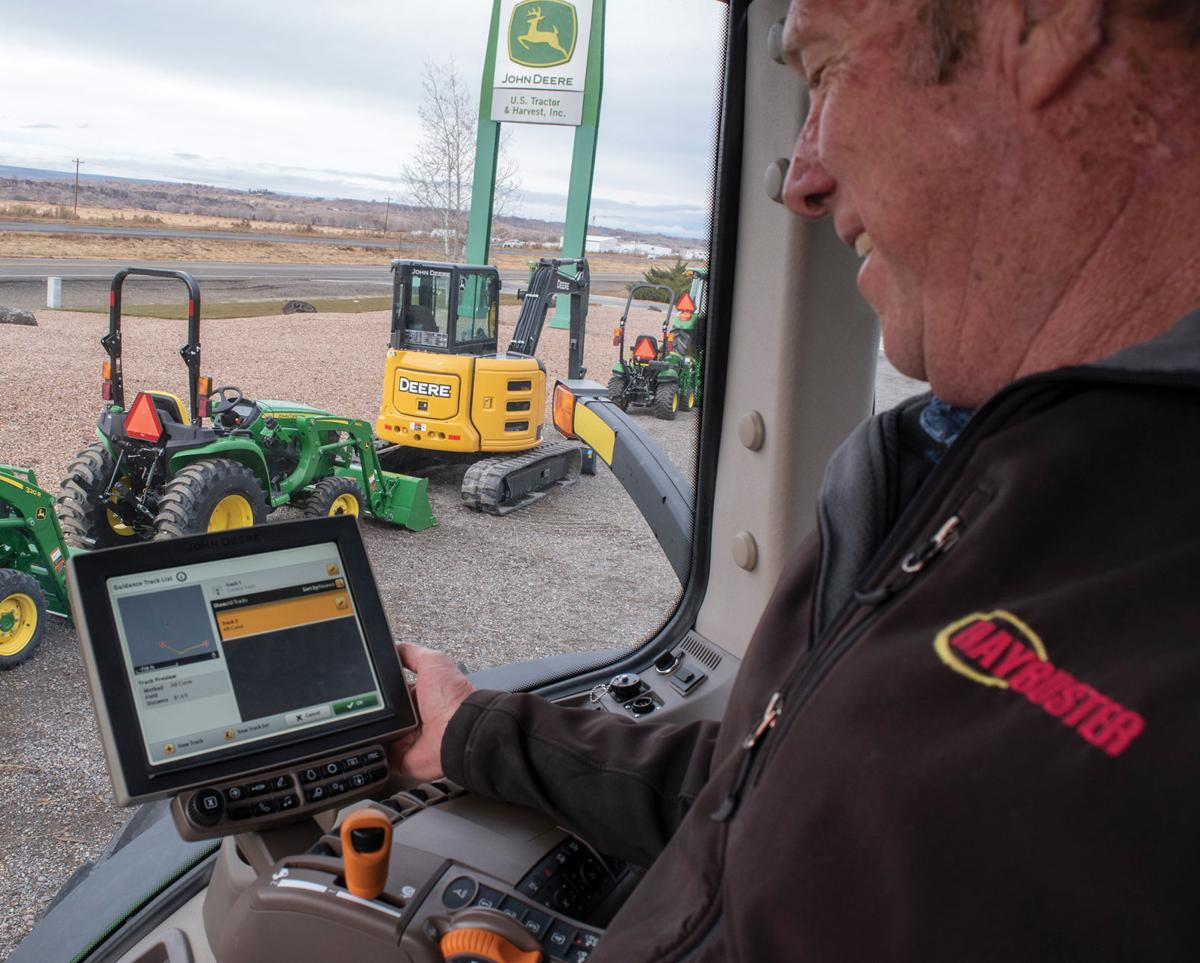 Rob Deines shows off the latest tractor guidance system