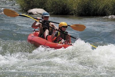 Boaters float down the Uncompahgre River