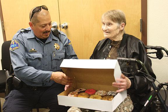 "Montrose County Sheriff's Office Deputy Dominic Lovato hands Nancy Moore her ""starter pack"""