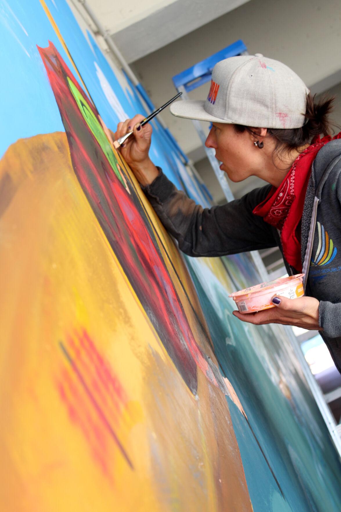 Heather painting kayak