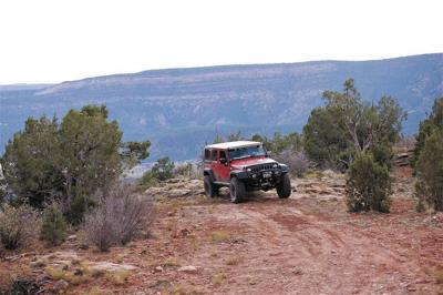 A Jeep travels the Rimrocker Trail on the western end of Montrose County