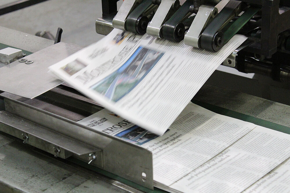 PHOTOS: Preparing the newspaper for delivery