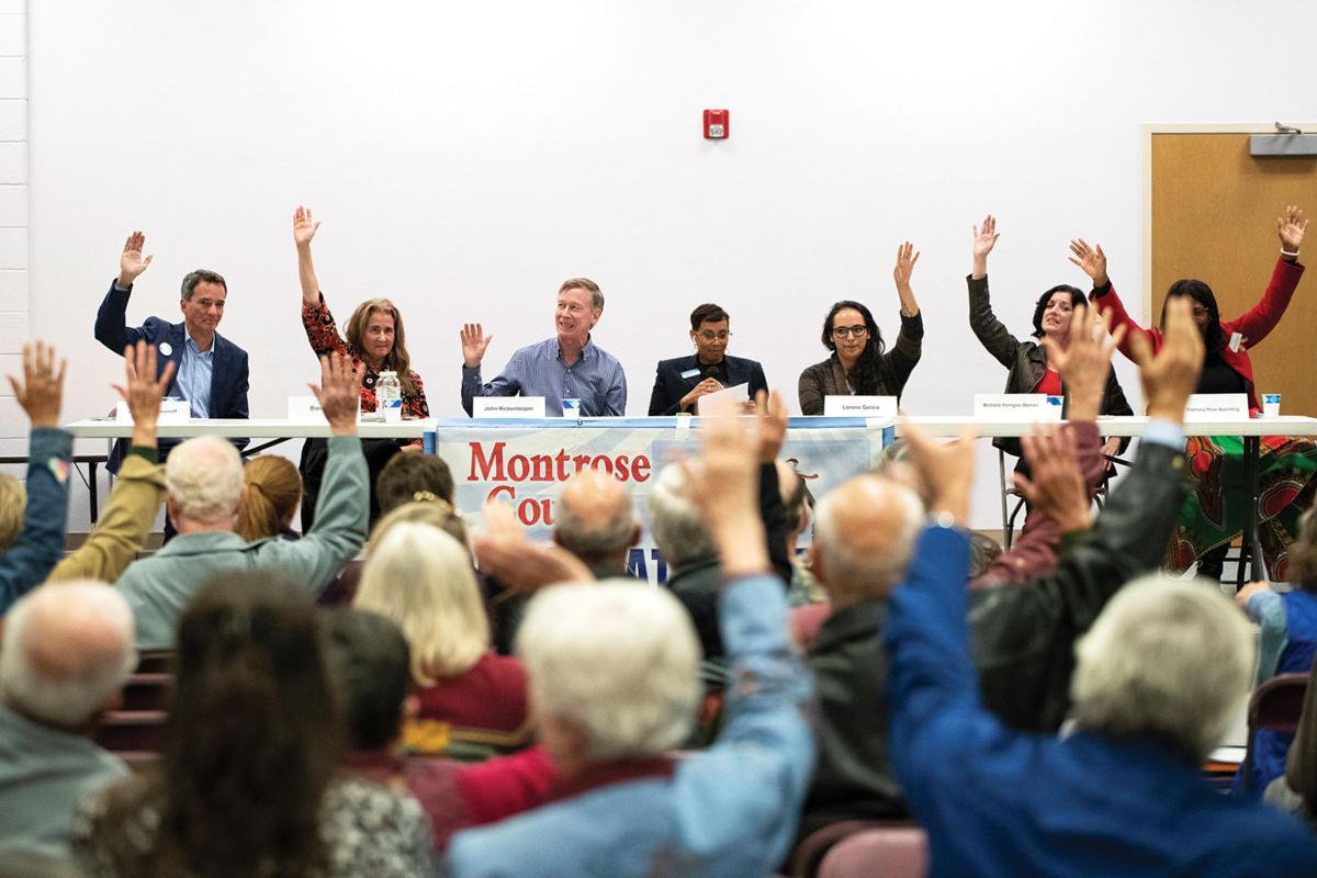Candidates raise hands
