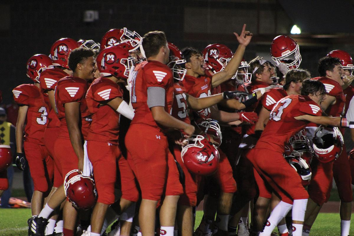 MHS footbal players celebrating after win