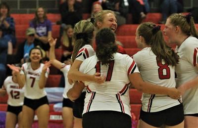 The Montrose High School volleyball team celebrates