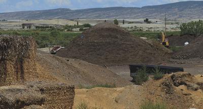 Piles of dirt at 3xM Grinding
