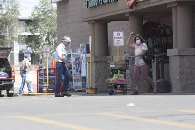 Shoppers enter City Market wearing masks