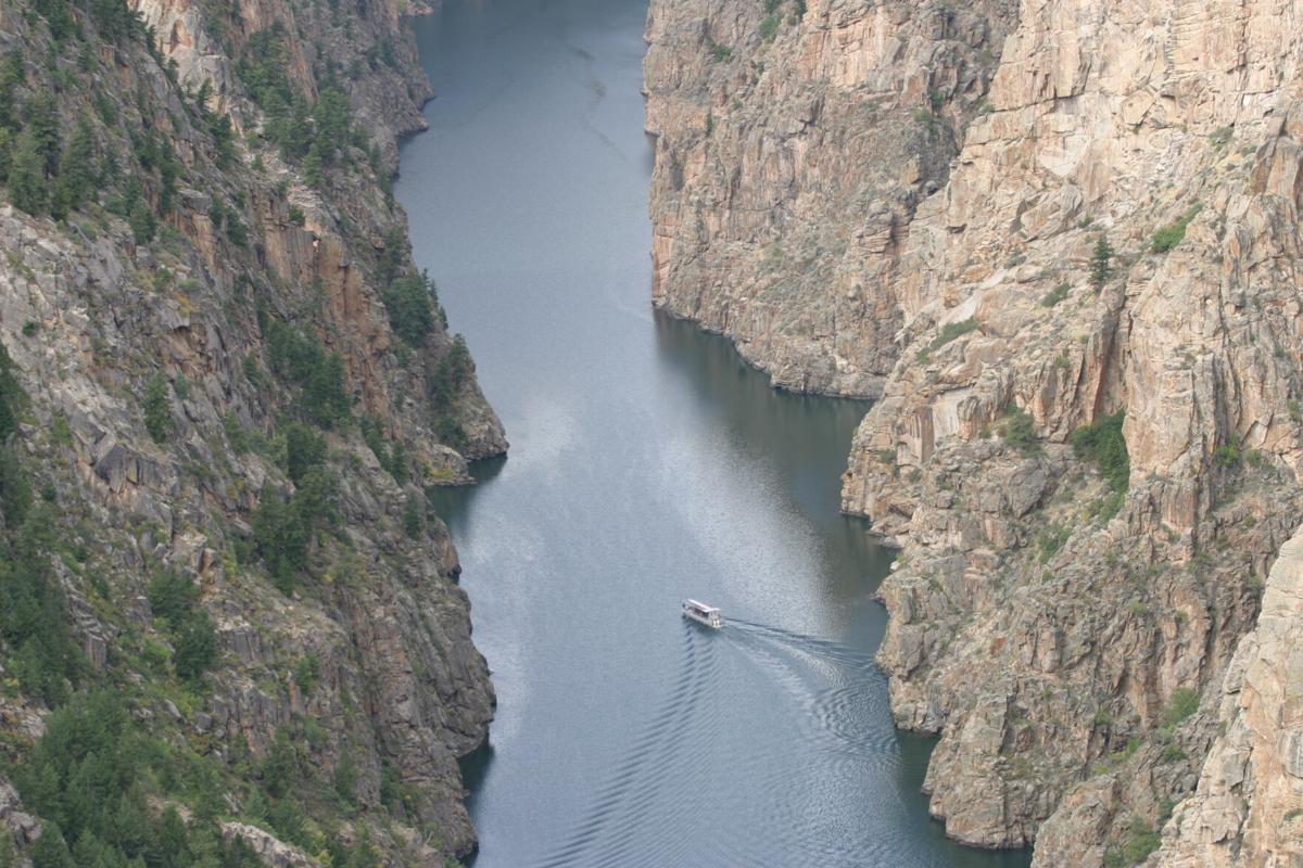 boat in canyon curecanti