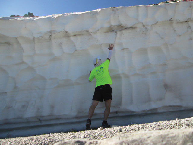 The author reaches high up the side of Imogene Pass