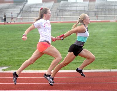 Montrose High School runners Katie Sherwood, left and Jade Replogle practice Tuesday for the relay team.