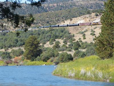 A train glides on the rails above the Colorado River