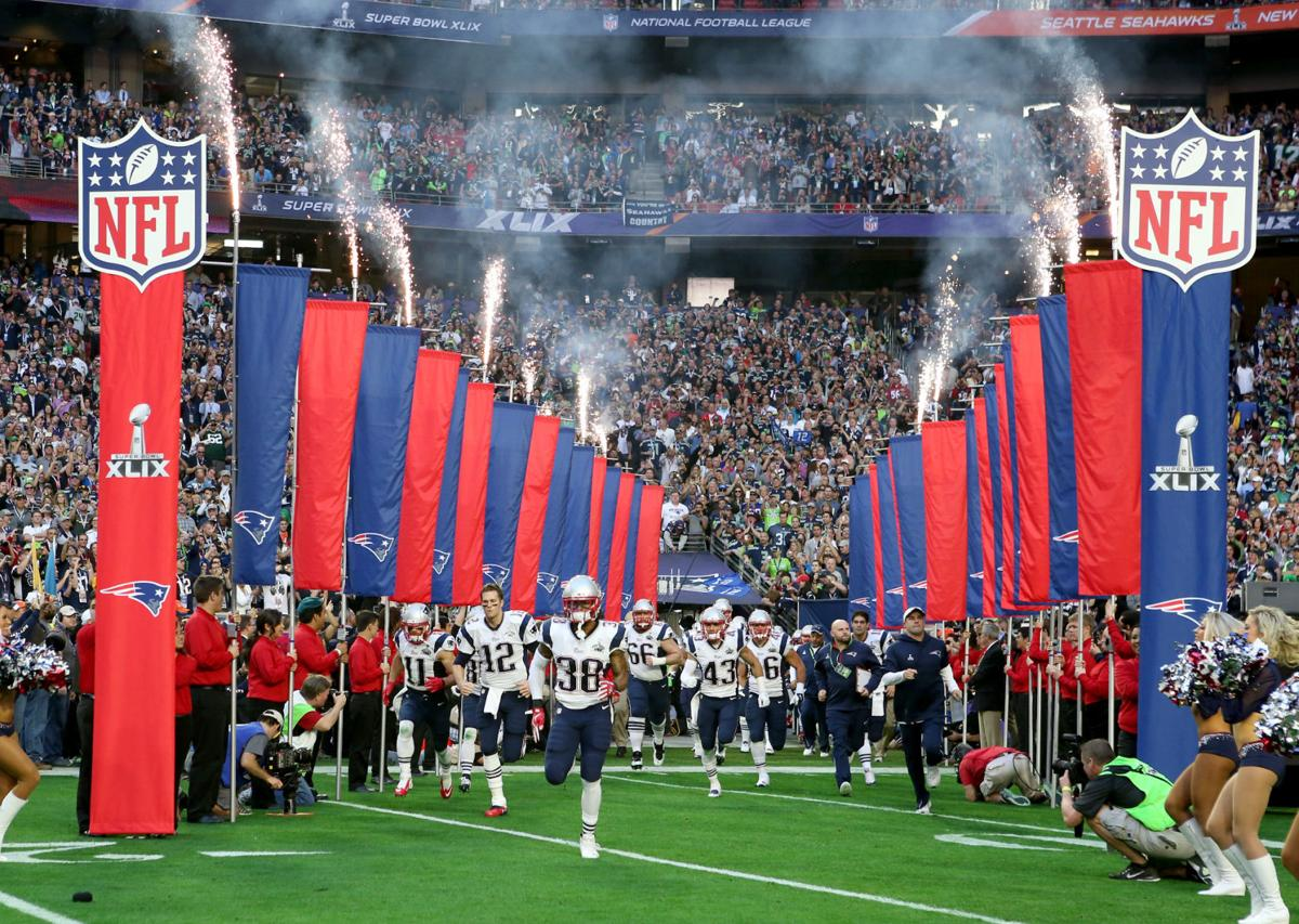 The New England Patriots take the field before the start of Super Bowl XLIX.