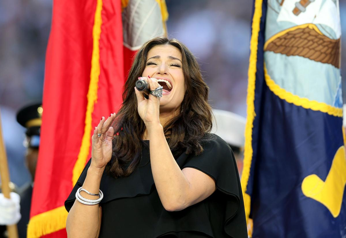 Idina Menzel sings the national anthem before the start of Super Bowl XLIX.
