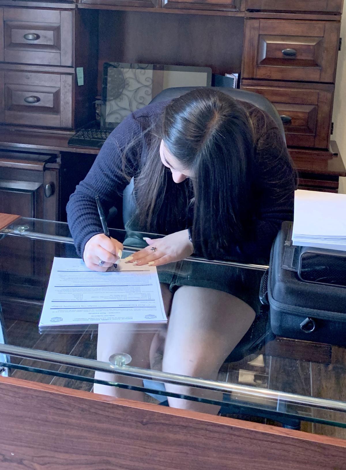 Itzel - signing 1.jpg