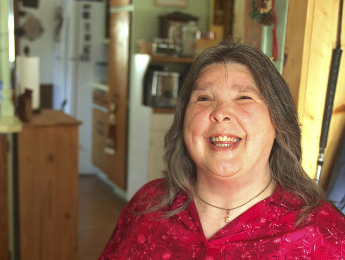 Blind author's faith spreads sunshine during rain
