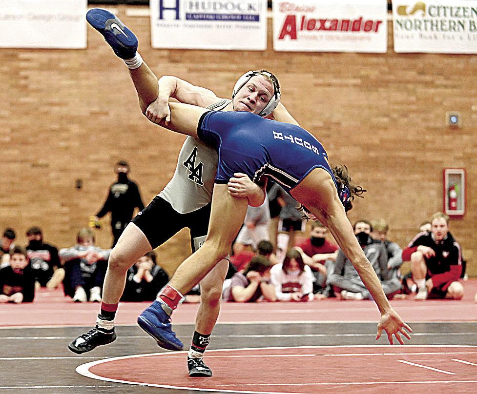 Bradley and Setzer advance to Northeast Regional wrestling tournament.