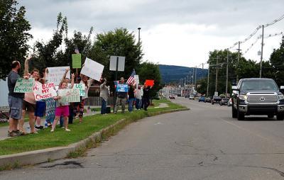 Crowd protests mask, vaccine mandates