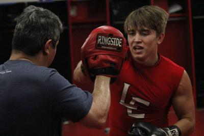 From the gridiron to the boxing ring:Red Devils using new ways to train during offseason
