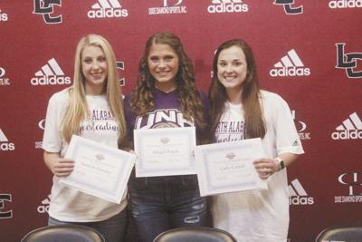 Three students sign to continue their careers at UNA