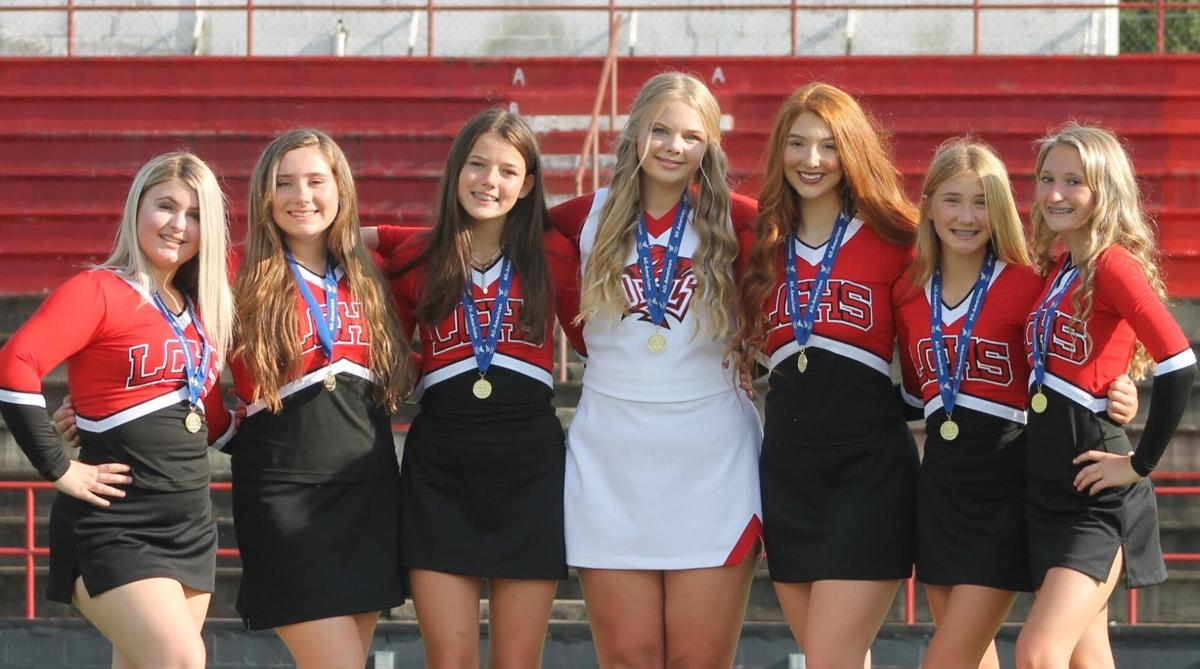 County cheerleaders shine at cheer camp