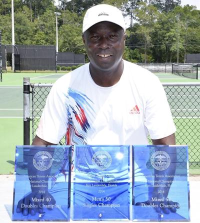 Lonnie White displays his trophies
