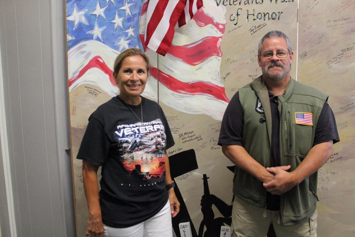 Museum volunteers Jackquie Riner (Navy Veteran) and J D Slater (Marine Corps veteran).