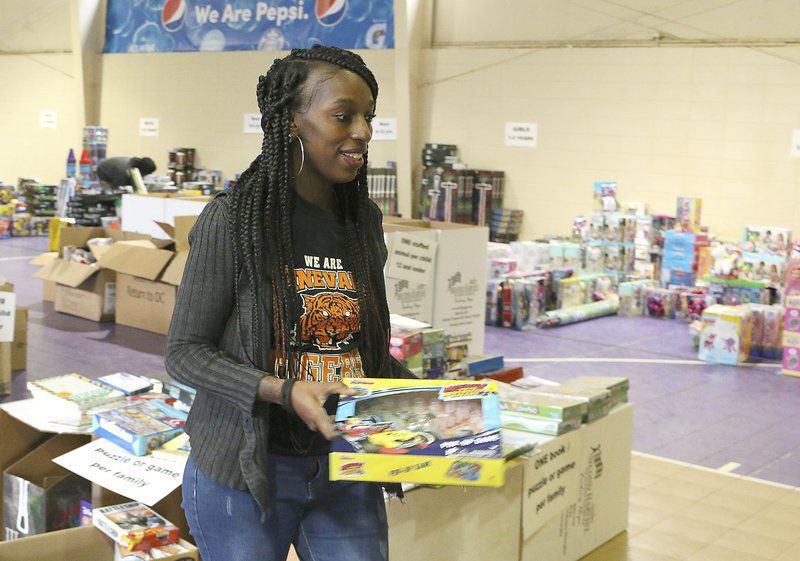 Delivering Presents: Empty Stocking Fund brings toys for Christmas