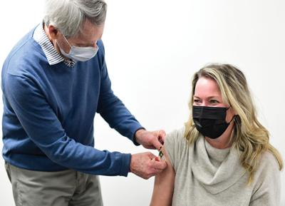 Dr. Tift Mann vaccinates Ketchum resident Amy Marx