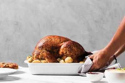 side-view-hands-putting-turkey-table.jpg