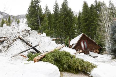 Avalanche damages Board Ranch houses 2