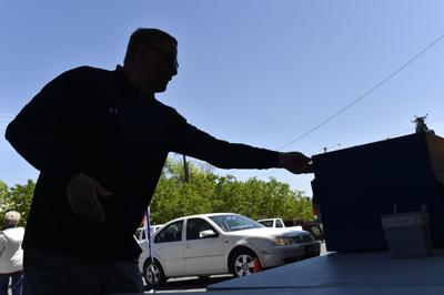 Voters drop off their ballots Tuesday outside the City-County Building in Helena.
