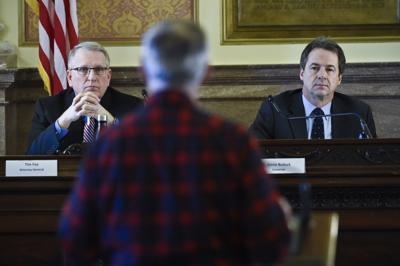 Attorney General Tim Fox, left, and Gov. Steve Bullock listen to testimony