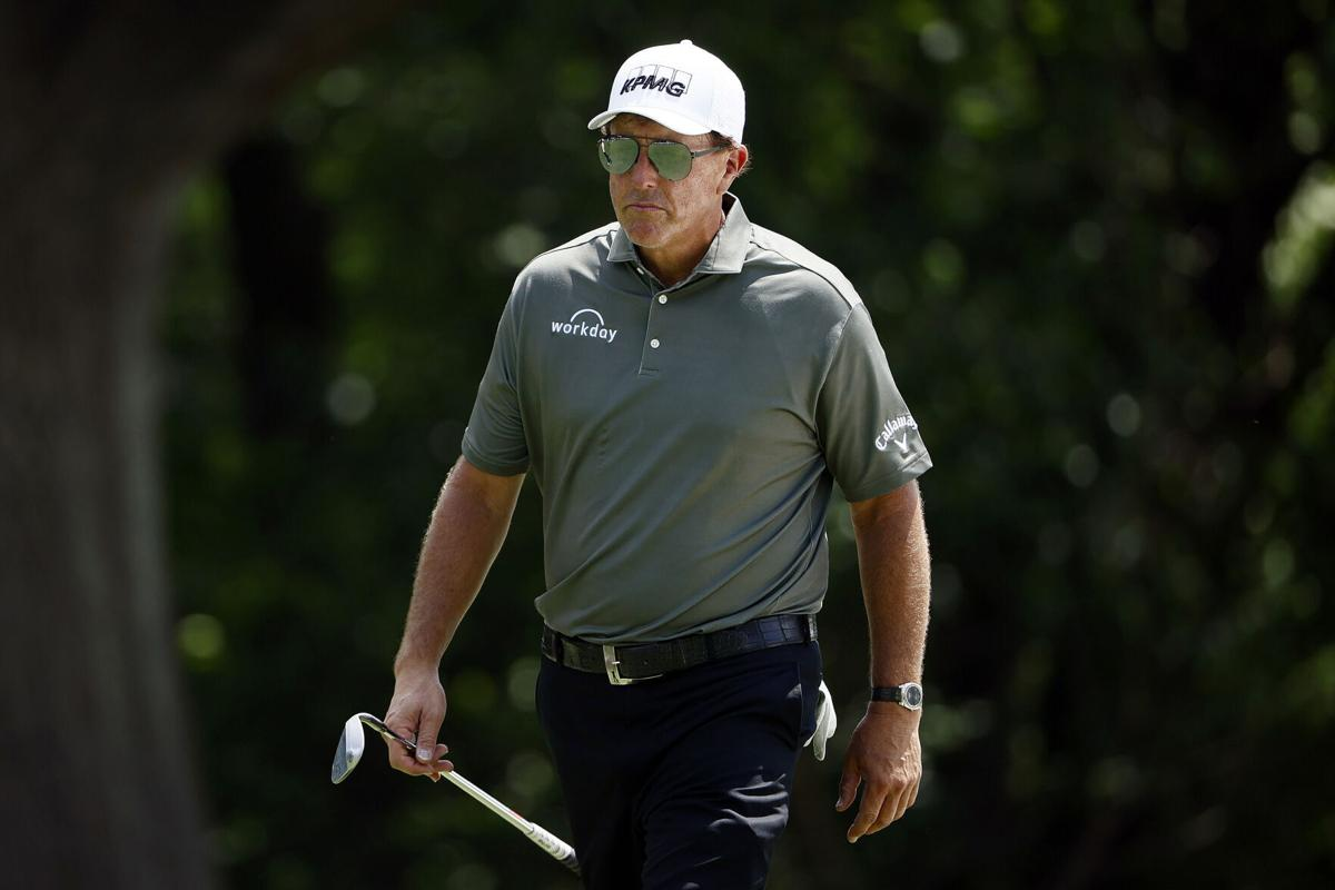 Phil Mickelson walks on the fifth hole during the first round of the Charles Schwab Challenge at Colonial Country Club on May 27, 2021 in Fort Worth, Texas.
