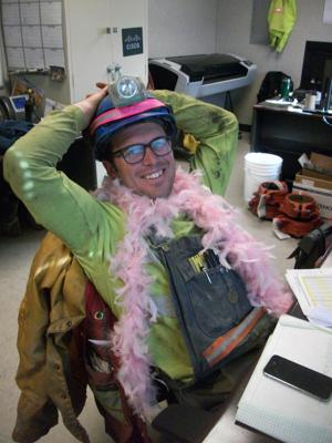 """""""Pretty in pink"""" Golden Sunlight miners raise $1,500 for St. James Healthcare"""
