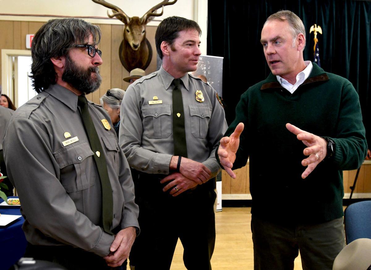 U.S. Interior Secretary Ryan Zinke talks with Park Service employees