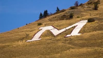 Hillside letters, symbols of town and school pride, are stamped on the Montana landscape