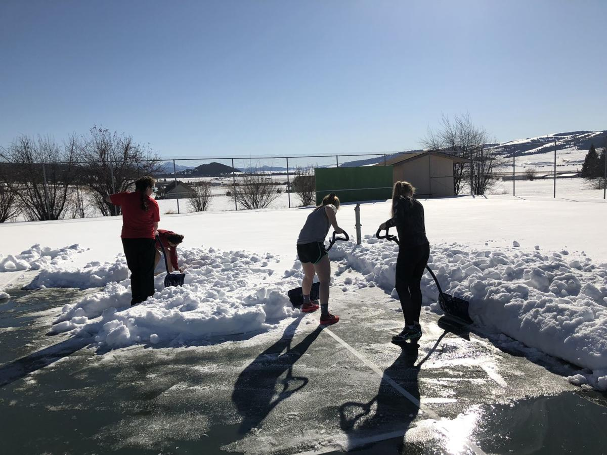 Philipsburg shoveling out their tennis courts
