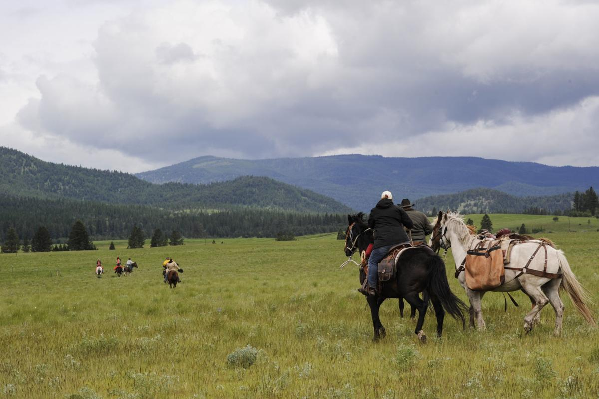 Riders on horse charge into the game range Friday at noon.