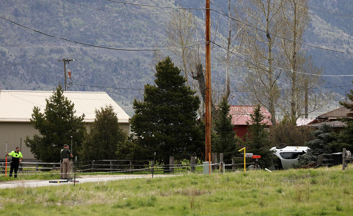 Police investigate crash, arrest two people
