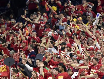 Kansas City Chiefs fans tomahawk-chop  as time runs off of the clock against the Houston Texans during the AFC Wild Card game on Saturday, Jan. 9, 2016, at NRG Stadium in Houston.