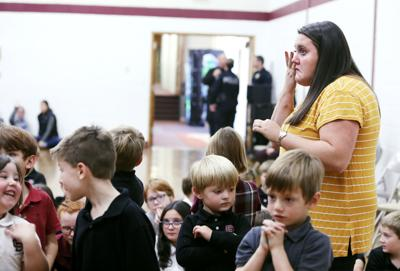 Reflecting on scary events, children and teachers gather for support