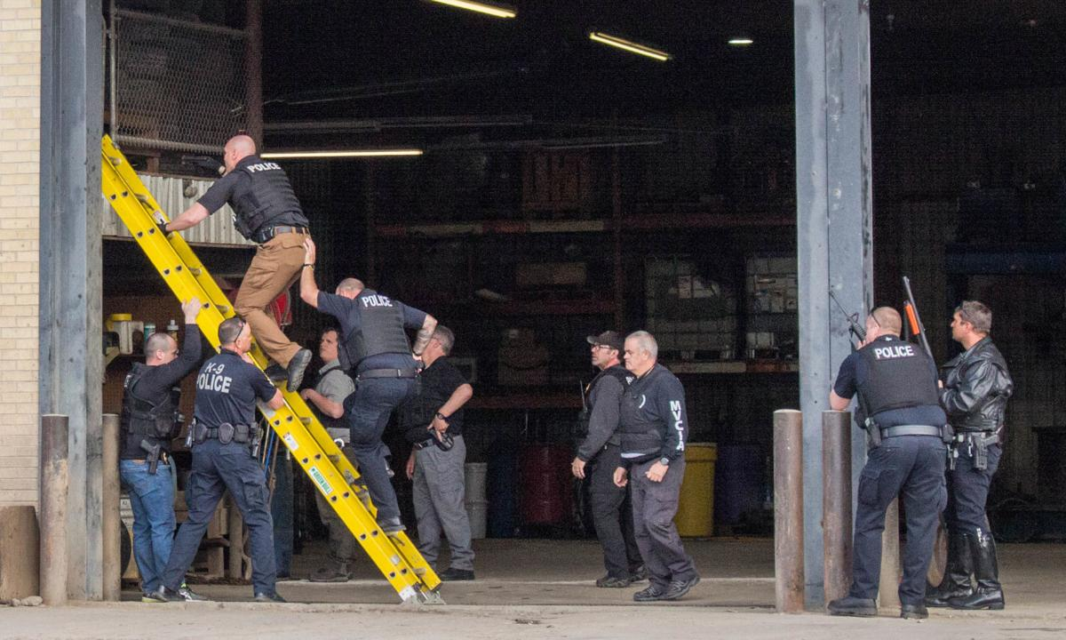 Man holes up on elevated platform in Butte tire shop
