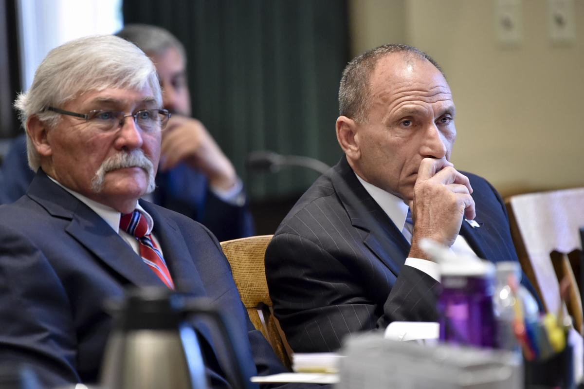 Gregg Trude, right, and defense attorney Greg Jackson