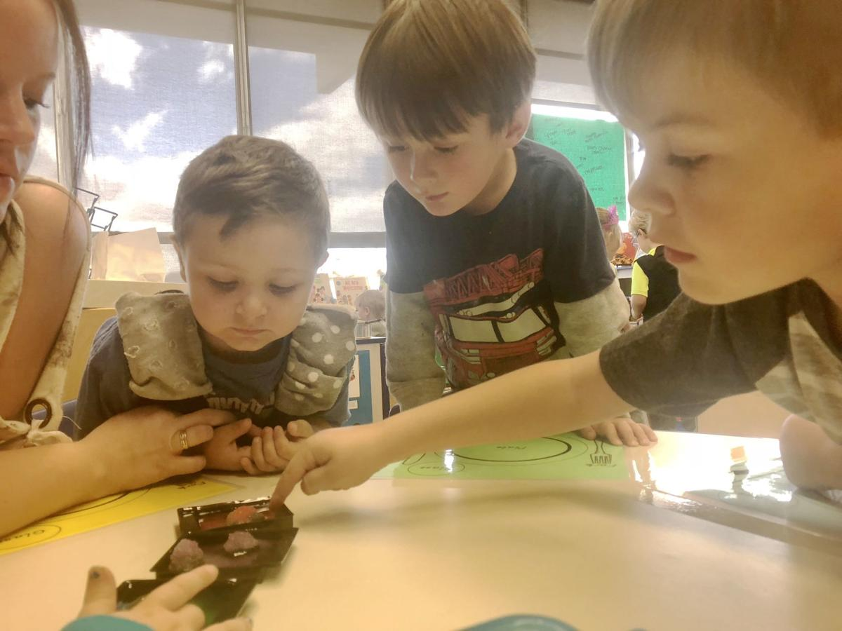 Head Start preschool students grow crystals during free choice time